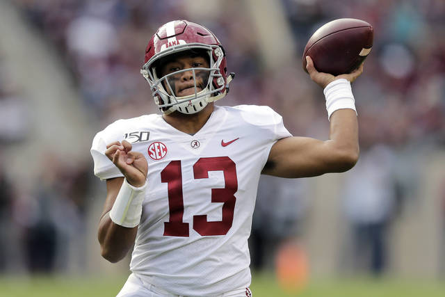 FILE - In this Oct. 12, 2019, file photo, Alabama quarterback Tua Tagovailoa passes against Texas A&M during the second half of an NCAA college football game in College Station, Texas.  (AP Photo/Sam Craft, File)