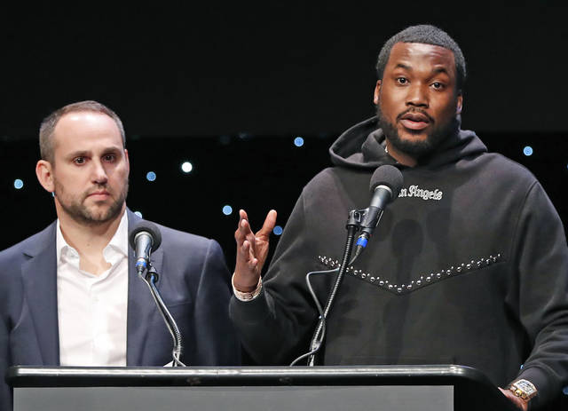 "FILE - In this Jan. 23, 2019, file photo, musician Meek Mill, right, speaks about his incarceration along with Philadelphia 76ers co-owner Michael Rubin at the launch of REFORM Alliance in New York. With factories closed, tens of millions out of work and a recession looming because of the coronavirus pandemic, athletes, teams, entertainers and business leaders are donating prized possessions in response to a challenge to feed families suddenly in need. The ""All In Challenge"" was started by Rubin on Tuesday, April 14, 2020, and some of the biggest names in sports and entertainment have answered the call, including Meek Mill. (AP Photo/Kathy Willens, File)"