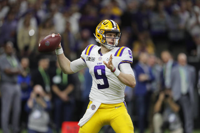 FILE - In this Jan. 13, 2020, file photo, LSU quarterback Joe Burrow throws a pass against Clemson during the second half of the NCAA College Football Playoff national championship game in New Orleans. The last time the Cincinnati Bengals had the top pick in the draft was 2003 when they took quarterback Carson Palmer, the Heisman Trophy winner from USC. They get to choose first again next week and are expected to take Heisman Trophy winner Burrow. (AP Photo/Gerald Herbert, File)