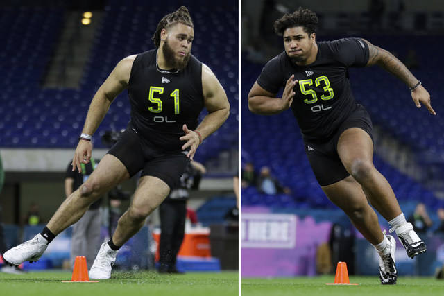 FILE - At left in a Feb. 28, 2020, file photo, Alabama offensive lineman Jedrick Wills runs a drill at the NFL football scouting combine in Indianapolis. At right, also in a Feb. 28, 2020, file photo, Iowa offensive lineman Tristan Wirfs runs a drill at the NFL football scouting combine in Indianapolis. The Browns are expected to grab a left tackle with the No. 10 overall in this year's NFL draft. There are four highly ranked tackles in this year's class and one should be available when the Browns are on the clock. (AP Photo/Michael Conroy, File)