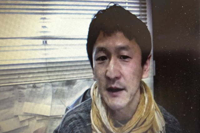 "In this screen shot image made from a video news conference by Foreign Correspondents' Club of Japan (FCCJ) in Tokyo, Japanese professor Kentaro Iwata speaks Monday, April 20, 2020. Iwata says he is ""very pessimistic"" the Olympics can be held next year in Japan. (FCCJ via AP)"
