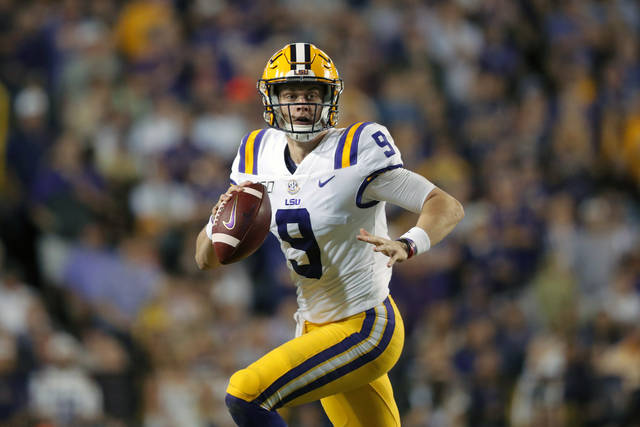 FILE - In this Nov. 30, 2019, file photo, LSU quarterback Joe Burrow (9) scrambles during the first half of an NCAA college football game against Texas A&M in Baton Rouge, La. Burrow is a posible first round pick in the NFL Draft Thursday night, April 23, 2020. (AP Photo/Gerald Herbert, File)