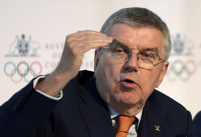 "FILE - In this May 4, 2019, file photo, International Olympic Committee President Thomas Bach speaks at the Australian Olympic Committee annual general meeting in Sydney, Australia. During an interview with a German newspaper Sunday, April 12, 2020, Bach says the International Olympic Committee will face ""several hundred million dollars""of added costs because of the postponement of the Tokyo Olympics until next year. (AP Photo/Rick Rycroft, File)"