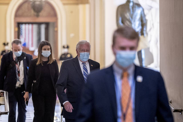 House Majority Leader Steny Hoyer of Md., second from right, walks off of the House floor on Capitol Hill, Thursday, April 23, 2020, in Washington. The House is expected to vote on a nearly $500 billion Coronavirus relief bill. (AP Photo/Andrew Harnik)