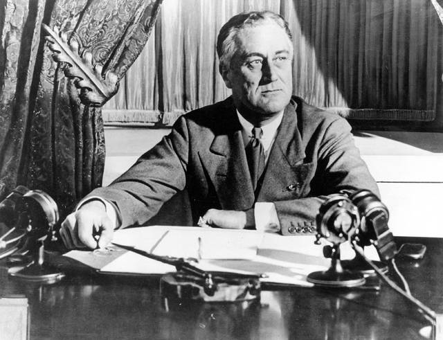 "FILE - In this March 1933, file photo, President Franklin D. Roosevelt delivers his first radio ""fireside chat"" in Washington. The New Deal was a try-anything moment during the Great Depression that remade the role of the federal government in American life. (AP Photo)"