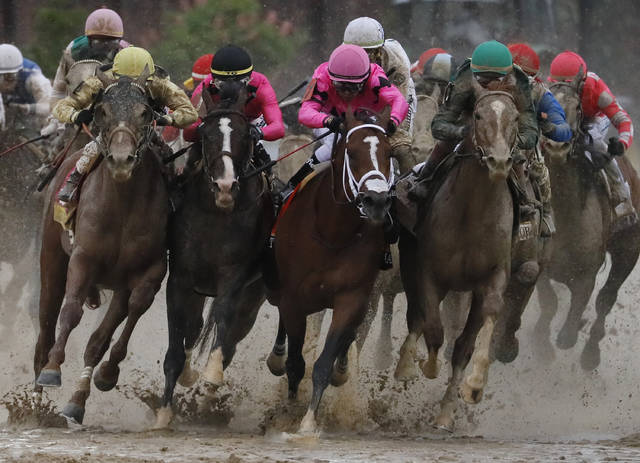 FILE - In this May 4, 2019, file photo, front row from left: Flavien Prat on Country House, Tyler Gaffalione on War of Will, Luis Saez on Maximum Security and John Velazquez on Code of Honor compete in the 145th running of the Kentucky Derby horse race at Churchill Downs in Louisville, Ky. There will be no Run for the Roses on this first Saturday in May. The Kentucky Derby is one of the events that won't be held this week because of the coronavirus pandemic. (AP Photo/John Minchillo, File)