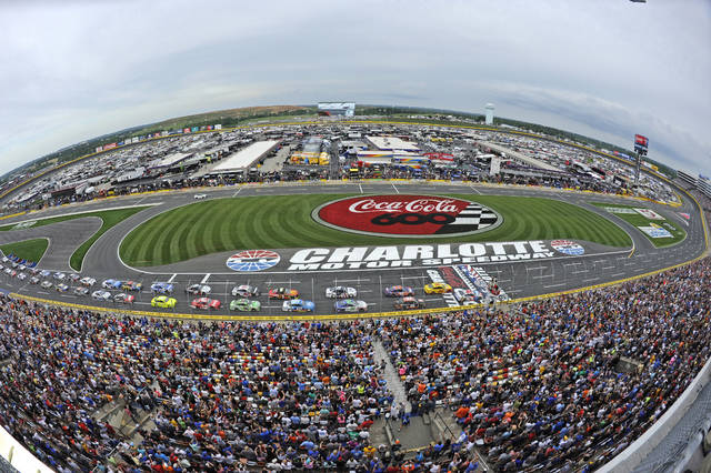 FILE - In this May 27, 2018, file photo, the field takes the green flag to start the NASCAR Cup Series auto race at Charlotte Motor Speedway in Concord, N.C. The governor of North Carolina says NASCAR can go forward with the Coca-Cola 600 at Charlotte Motor Speedway at the end of May so long as health conditions do not deteriorate in the state. Gov. Roy Cooper said Tuesday he and state public health officials have had discussions with NASCAR and the speedway regarding its safety protocols for staging a race without spectators. Cooper said the state offered input on NASCAR's plan, but he believes the race can go forward on Memorial Day weekend for the 60th consecutive year.  (AP Photo/Mike McCarn, file)