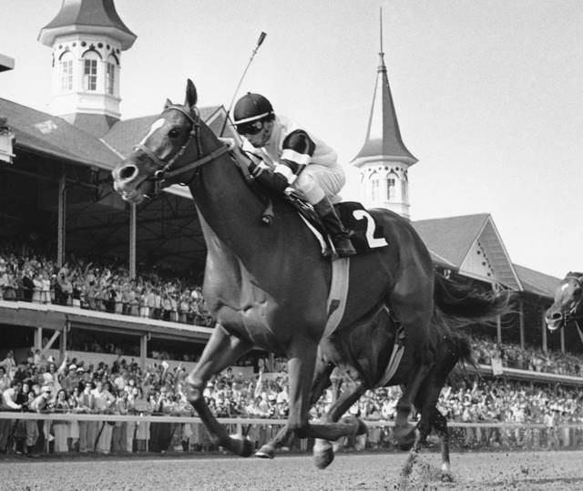 FILE - In this May 6, 1978, file photo, Affirmed, jockey Steve Cauthen up, crosses the finish line to win the Kentucky Derby in Louisville, Ky. Secretariat is the early 7-2 favorite for this weekend's virtual Kentucky Derby, an animated race pitting all 13 Triple Crown winners on the day the Derby would have been held before the coronavirus pandemic postponed it. Citation, who won the 1948 Triple Crown, was made the 4-1 second choice. Seattle Slew and Affirmed, the 1977 and '78 Triple Crown winners, were each listed at 5-1 odds. (AP Photo/File)