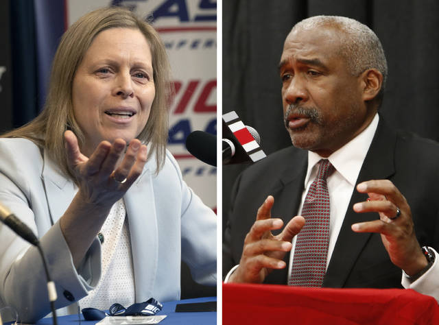 FILE - At left, in a March 12, 2020, file photo, Big East Conference Commissioner Val Ackerman speaks to reporters in New York. At right, in a Dec. 4, 2018, file photo, Ohio State athletics director Gene Smith answers questions during a news conference in Columbus, Ohio. The NCAA announced Wednesday, April 29, 2020, that its Board of Governors supports a plan that gives athletes the ability to cash in on their names, images and likenesses as never before and without involvement from the association, schools or conferences. The board  on Monday and Tuesday, April 27-28, 2020, reviewed detailed recommendations put forth by a working group led by Ohio State athletic director Gene Smith and Big East Commissioner Val Ackerman. (AP Photo/File)