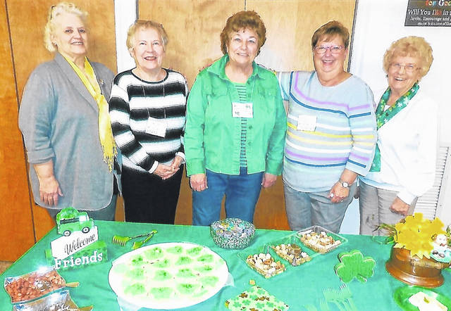 From left are speaker Judy Grosvenor and hostesses Sue Lamke, Diann Nadeau, Linda Compton and Wanda Everman.