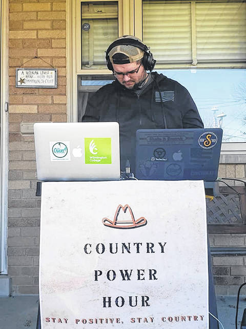 Station manager Josh Woodward broadcasts his Country Power Hour Show three times a week from his home in Cincinnati.