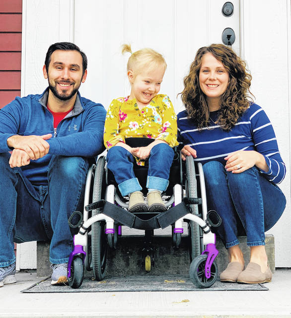 Hannah and Andrew Roberts with four-year-old Emma Kate.