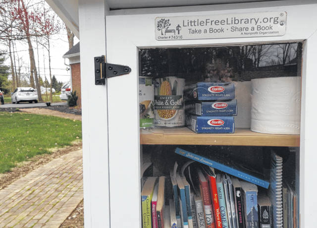 Boxed spaghetti, canned goods and toilet paper have been added to the fare of books available at this Little Free Library on Timber Lane in Wilmington. Little Free Libraries are public bookcases where book sharing takes place — those taking a book are asked to leave one in its place for someone else to enjoy. Eileen Brady decided to put the top shelf of her Little Free Library to a different and timely use.