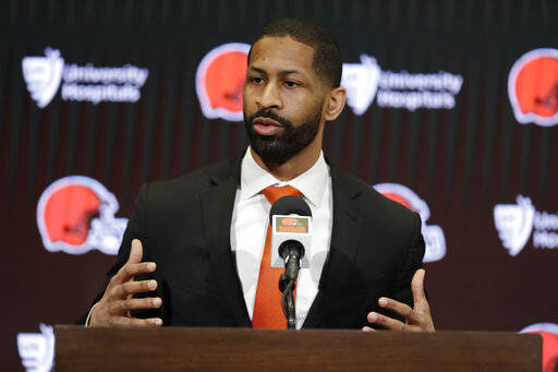 "FILE - In this Feb. 5, 2020, file photo, Cleveland Browns general manager Andrew Berry speaks during a news conference at the NFL football team's training camp facility in Berea, Ohio. The Browns first-time general manager said Friday, April 10, 2020, that he's not worried about any logistical challenges that may arise during the upcoming draft, which has been forced to go virtual due to the COVID-19 pandemic. Berry said the Browns are prepared for all scenarios and he's confident the team can handle any worst-case, ""Armageddon"" scenarios while picking players.(AP Photo/Tony Dejak, File)"