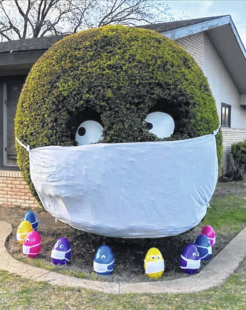 The niece of a Clinton County woman, Dee Mosser of Cuba Road, was part of a team that transformed a bush and Easter eggs at Life Care Center in Orlando, Florida into something to smile about. The creation also serves as a model for wearing masks when in public. The niece's name is Kayla Holliman, who visits her Aunt Dee yearly, and who works at Life Care Center as a physical therapist assistant.