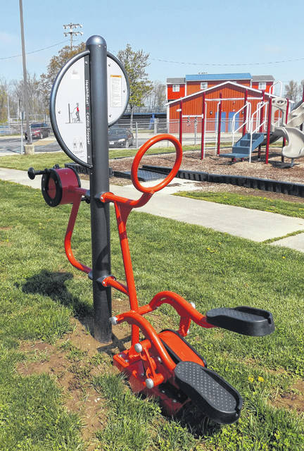 Two pieces of equipment recently were added to an outdoor fitness area located on the Clinton-Massie campus. One of the new items is the exercise equipment in the photo that has a cardio stepper on one side (foreground) and a hand cycler on the other side. The other new item is a low-height balance beam that has a twisty design, no doubt with children in mind. The outdoor fitness area also has Tai Chi wheels. The space is an ongoing project led by Clinton-Massie District School Nurse and grant writer Cindy Stenger who has obtained HealthFirst grants to fund the equipment. The equipment is intended for use by the community. She's looking for grants to turf the area so that muddy ground won't stop would-be users. For the time being, due to the coronavirus and the equipment having high-touch surfaces, interested residents should wait for clearance, probably about the time playground equipment at public parks is regarded safe for use.