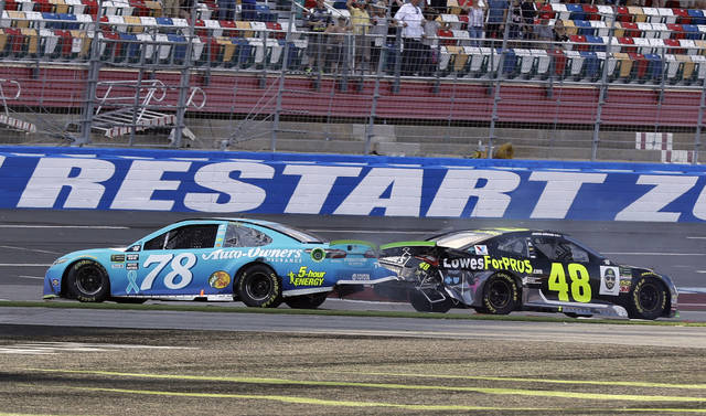 FILE - In this Sept. 30, 2018, file photo, Martin Truex Jr., (78) and Jimmie Johnson (48) crash on the final lap during the NASCAR Cup series auto race at Charlotte Motor Speedway in Concord, N.C. Charlotte Motor Speedway will host the Coca-Cola 600 on May 24, 2020, to mark 60 consecutive years the longest race on the NASCAR schedule will be held on Memorial Day weekend. The track in Concord will then host a Wednesday race three days later. (AP Photo/Chuck Burton, File)