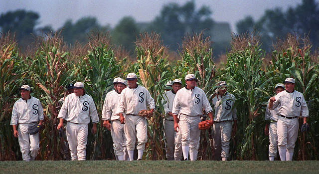 """FILE - In this undated file photo, people portraying ghost players emerge from a cornfield as they reenact a scene from the movie """"Field of Dreams"""" at the movie site in Dyersville, Iowa. The 1989 film was No. 6 in The Associated Press' Top 25 favorite sports movies poll. (AP Photo/Charlie Neibergall, File)"""