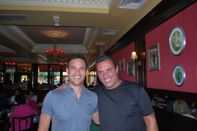 In this July 18, 2015,  photo provided by Brad Balukjian, Brad Balukjian, left, stands with former major league outfielder Lee Mazzilli in Rye, N.Y. Balukjian tore open a pack of 1986 Topps baseball cards, chewed the stale, brittle bubblegum and then planned a journey most sports fans could only dream about. The self-funded trip in 2015, to meet every player whose image appeared on those old pieces of cardboard, cost about $8,000 and took him across 30 states over 11,341 miles in 48 days — fueled by 123 cups of coffee.  (Brad Balukjian via AP)