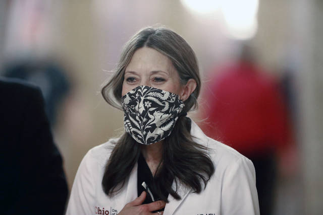 Ohio Department of Health Director Dr. Amy Acton walks into her daily coronavirus news conference on Friday, April 17, 2020 at the Ohio Statehouse in Columbus, Ohio. (Doral Chenoweth/The Columbus Dispatch via AP)