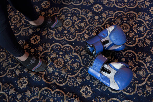 Boxing gloves of Eyed Akeel Khan lie on the floor of the room where he practices in Srinagar, Indian controlled Kashmir, April 23, 2020. Like many other athletes, the coronavirus pandemic has restricted Khan to his home. But lockdown for the 7 million residents of Kashmir is nothing new and the ongoing restrictions due to the pandemic is not the first time he has had to practice his sport at home. (AP Photo/Dar Yasin)