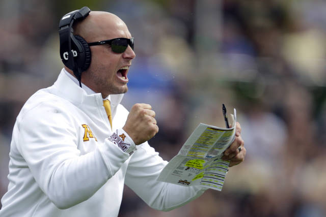 FILE - In this Sept. 28, 2019, file photo, Minnesota head coach P.J. Fleck celebrates a touchdown during the first half of an NCAA college football game against Purdue in West Lafayette, Ind. The coronavirus is preventing prospects from leaving home to visit campuses and is keeping college coaches from traveling to evaluate players across the country.  (AP Photo/Michael Conroy, File)
