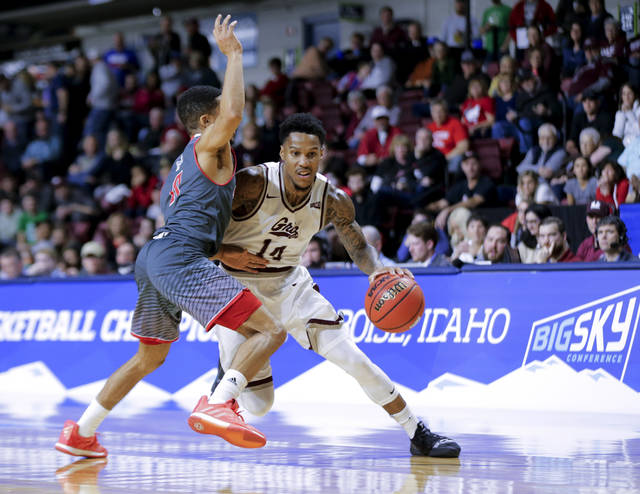 "FILE - In this March 16, 2019, file photo, Montana's Ahmaad Rorie (14) tries to move the ball around Eastern Washington's Tyler Kidd during an NCAA college basketball game in the championship of the Big Sky men's tournament in Boise, Idaho. The cancellation of the NCAA Tournament has produced a budget crunch that leaves colleges everywhere looking for cost-saving measures. Chattanooga announced last month that any 2020-21 away games that hadn't already been scheduled must be played within 150 miles of its campus. ""A 150-mile radius isn't going to do anything for us here in Montana,"" Montana athletic director Kent Haslam said. ""Some people can't even get to a Walmart within 150 miles."" (AP Photo/Otto Kitsinger, File)"