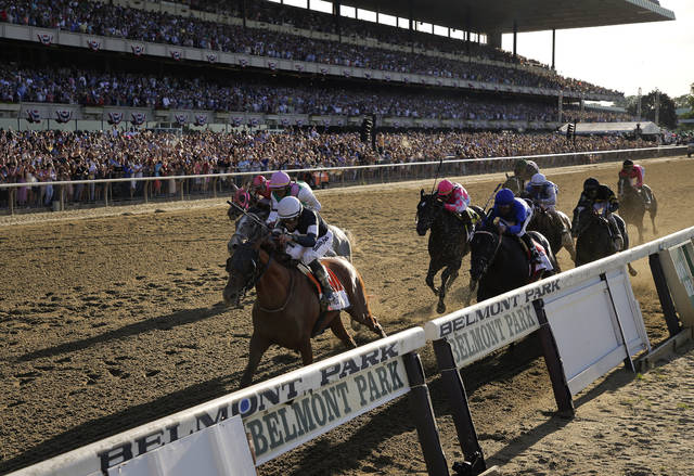 FILE - In this June 8, 2019, file photo, Sir Winston (7), with jockey Joel Rosario up, crosses the finish line to win the 151st running of the Belmont Stakes horse race at Belmont Park in Elmont, N.Y. The Belmont Stakes will be run June 20, 2020, without fans and serve as the opening leg of horse racing's Triple Crown for the first time in the sport's history. The New York Racing Association on Tuesday, May 19, 2020, unveiled the rescheduled date for the Belmont, which will also be contested at a shorter distance than usual. This is the first time the Belmont will lead off the Triple Crown ahead of the Kentucky Derby and Preakness. (AP Photo/Seth Wenig, File)