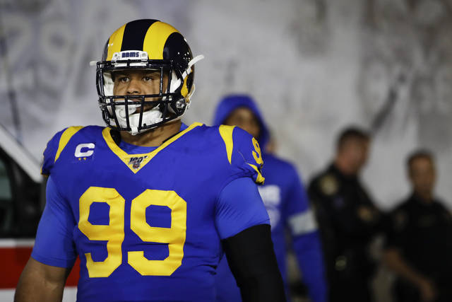 """In this Dec. 8, 2019, photo, Los Angeles Rams defensive tackle Aaron Donald waits to run onto the field for an NFL football game against the Seattle Seahawks in Los Angeles. Donald is not thrilled about the prospect of playing football without fans. The Rams' superstar defensive lineman doesn't see how the NFL could play a season in front of empty seats, saying it """"wouldn't be fun to me."""" (AP Photo/Marcio Jose Sanchez)"""
