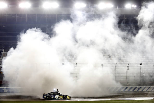 Chase Elliott does a burnout after winning a NASCAR Cup Series auto race at Charlotte Motor Speedway Thursday, May 28, 2020, in Concord, N.C. (AP Photo/Gerry Broome)