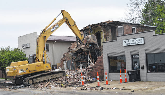 The long-abandoned building on Sugartree St. is torn down Tuesday morning.