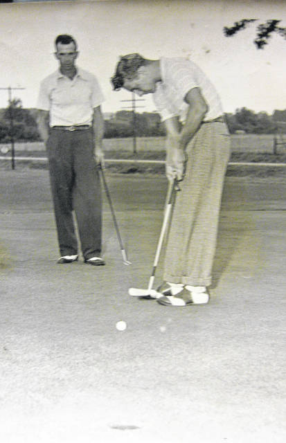 "This photo states, ""Tom Carey, new Snow Hill golf champion, sinks putt as Glen R. Murphy watches. Carey beat Murphy 4-3."" It is dated Sept. 5, 1948. Can you tell us more? Share it at info@wnewsj.com. The photo is courtesy of the Clinton County Historical Society. Like this image? Reproduction copies of this photo are available by calling the History Center. For more info, visit www.clintoncountyhistory.org; follow them on Facebook @ClintonCountyHistory; or call 937-382-4684."