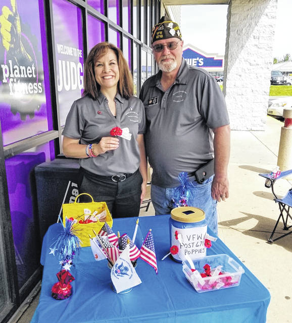 VFW Auxiliary Unit 6710 President-Elect Tracy Hopkins and VFW Post 6710 Commander Richard James at the Dollar Tree location.