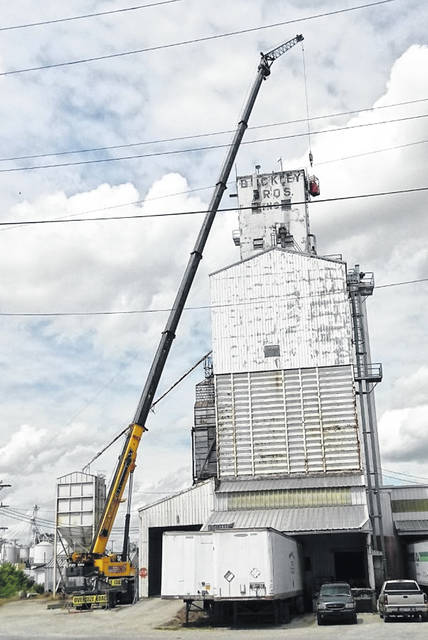 A worker had a good view of downtown Wilmington as well as an up-close view of the Buckley Bros. grain elevator while working on phone equipment this week.