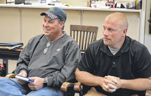 At the Clinton County Commissioners Office on Wednesday are, from left, Clinton County Agricultural Society President Scot Gerber and Vice President Kevin Garen.