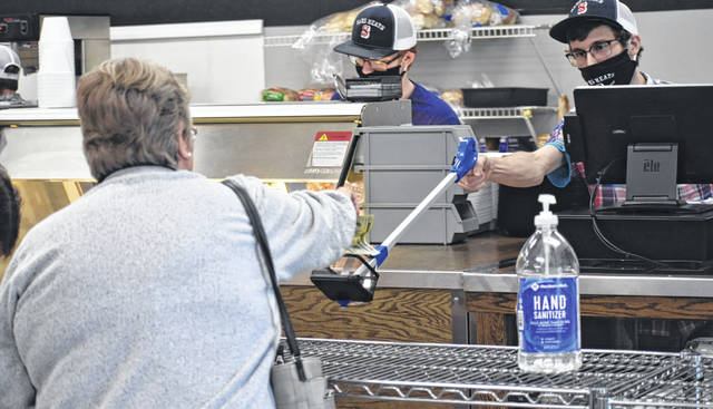 Sams Meats & Deli in Wilmington has been observing safety protocols, including employees wearing masks and keeping socially distanced from customers, including at the deli counter.