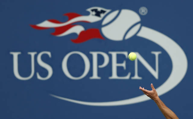 FILE - In this Sept. 2, 2017, file photo, Philipp Kohlschreiber, of Germany, serves to John Millman, of Australia, during the third round of the U.S. Open tennis tournament in New York. A high-ranking official for the U.S. Open tells the Associated Press that if the Grand Slam tennis tournament is held in 2020, she expects it to be at its usual site in New York and in its usual dates starting in August.  (AP Photo/Adam Hunger, File)