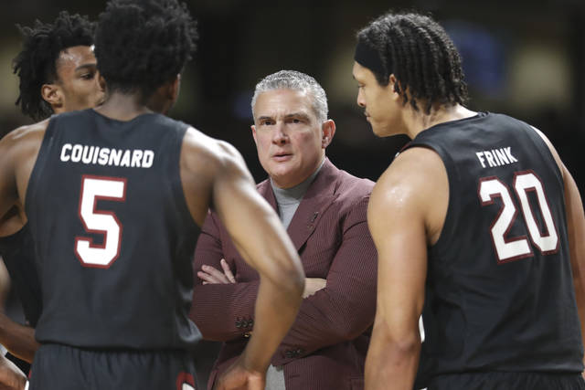 FILE - In this March 7, 2020, file photo, South Carolina head coach Frank Martin talks to Jermaine Couisnard (5) and Alanzo Frink (20) in the second half of an NCAA college basketball game against Vanderbilt in Nashville, Tenn. Martin is joining dozens of college basketball coaches in taking action on racism and diversity. The NABC announced Martin would chair a new committee designed to address issues of race and discrimination and not only within college sports. (AP Photo/Mark Humphrey, File)