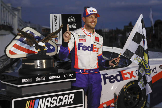 Denny Hamlin smiles after winning the NASCAR Cup Series auto race at Pocono Raceway, Sunday, June 28, 2020, in Long Pond, Pa. (AP Photo/Matt Slocum)