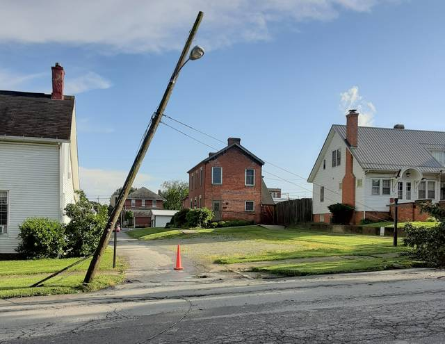 AEP said power was out in parts of Hillsboro throughout the evening on Wednesday when a line of severe thunderstorms and high winds rolled through the city. A large uprooted pine tree in the front yard of a residence on E. Beech St. almost brought down a utility pole. Motorists had to use extreme caution as power lines were laying in the roadway on some neighborhood streets