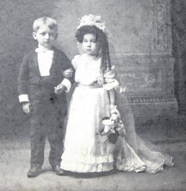 """Reece Tener and Bonnie (Edwards) Reynolds in a """"Tom Thumb wedding"""" in New Vienna around 1910. Can you tell us more? Share it at info@wnewsj.com. The photo is courtesy of the Clinton County Historical Society. Like this image? Reproduction copies of this photo are available by calling the History Center. For more info, visit www.clintoncountyhistory.org; follow them on Facebook @ClintonCountyHistory; or call 937-382-4684."""
