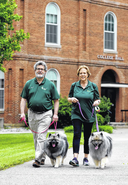 Jim and Sue Reynolds and their Keeshund canines, Phoebe and Georgia, regularly have walked around Collett Mall during the evening — much to the delight of students. They said the dogs sensed a palpable loss this spring when students were forced to finish the term online.