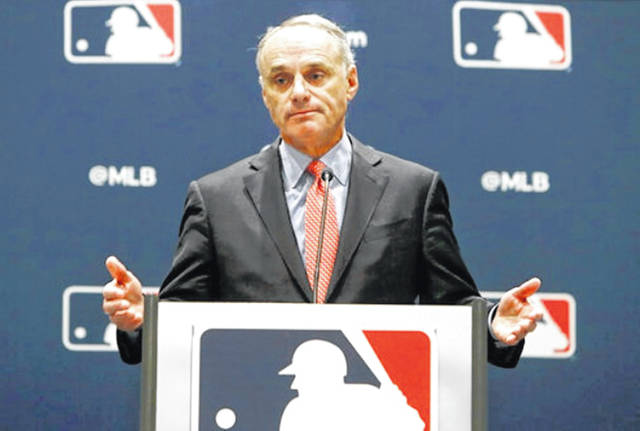 In this Nov. 21, 2019, file photo, baseball commissioner Rob Manfred speaks to the media at the owners meeting in Arlington, Texas. The chance that there will be no Major League Baseball season increased substantially Monday, June 15, 2020, when the commissioner's office told the players' association it will not proceed with a schedule amid the coronavirus pandemic unless the union waives its right to claim management violated a March agreement between the feuding sides. (AP Photo/LM Otero, File)