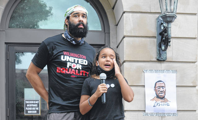 From left is George Byrd, an organizer of the anti-racism event, and his daughter Autumn.