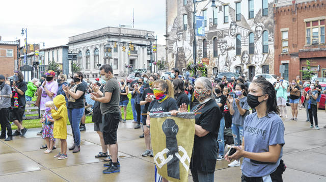 "The ""Wilmington United for Equality"" rally Saturday on the north side of the Clinton County Courthouse was well-attended, and remained so despite a period of heavy, sideways rain that blew in."