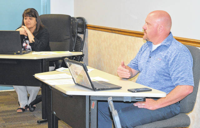 From left, Wilmington City Schools (WCS) Treasurer Kim DeWeese and WCS Director of Business Operations Curt Bone have financial matters on their minds.
