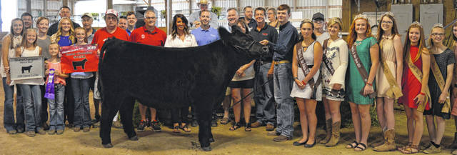 Shown at last year's fair are Adam Thompson with his 1,265-pound Grand Champion Market Beef steer and its buyers, who purchased it for a $7,850 premium at the Clinton County Junior Fair livestock sales.