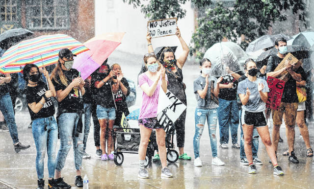 """A hard rain did not dampen the enthusiasm for the cause at the """"United for Equality"""" rally in Wilmington."""
