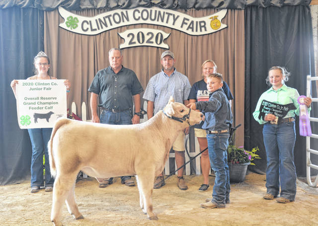 Overall Reserve Champion Beef Feeder winner was Carson Barton (front), shown with family members as well as Beef Queen Haley Dean and Judge Rick Davis.