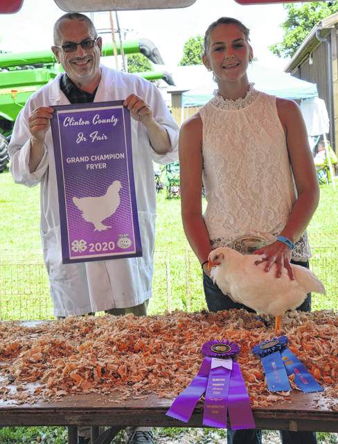 In the Market Poultry Show, Grand Champion Meat Fryer winner was Ava Hester, shown with Judge Rick Bokanyi.